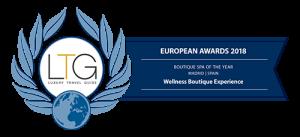 Logotipo azul del premio al mejor Spa de España otorgado por Luxury travel guide